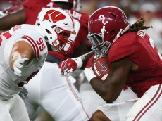 ARLINGTON, TX - SEPTEMBER 05:  Derrick Henry #2 of the Alabama Crimson Tide is tackled by Arthur Goldberg #95 of the Wisconsin Badgers in the first quarter during the Advocare Classic at AT&T Stadium on September 5, 2015 in Arlington, Texas.  (Photo by Ronald Martinez/Getty Images)