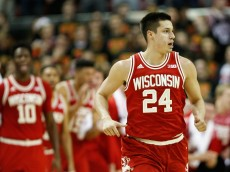 COLLEGE PARK, MD - FEBRUARY 13: Bronson Koenig #24 of the Wisconsin Badgers celebrates after hitting a shot in the second half against the Maryland Terrapins at Xfinity Center on February 13, 2016 in College Park, Maryland. Wisconsin won 70-57.  (Photo by Rob Carr/Getty Images)