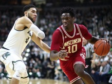 EAST LANSING, MI - FEBRUARY  18:  Nigel Hayes #10 of the Wisconsin Badgers drives past Denzel Valentine #45 of the Michigan State Spartans in the first half at the Breslin Center on February 18, 2016 in East Lansing, Michigan. (Photo by Rey Del Rio/Getty Images)