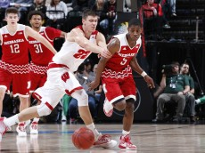 INDIANAPOLIS, IN - MARCH 10: Glynn Watson Jr. #5 of the Nebraska Cornhuskers knocks the ball away from Ethan Happ #22 of the Wisconsin Badgers in the second round of the Big Ten Basketball Tournament at Bankers Life Fieldhouse on March 10, 2016 in Indianapolis, Indiana. (Photo by Joe Robbins/Getty Images)