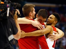 ST LOUIS, MO - MARCH 18:  Ethan Happ #22 of the Wisconsin Badgers (C) and Jordan Hill #11 (R) celebrate defeating the Pittsburgh Panthers 47-43 during the first round of the 2016 NCAA Men's Basketball Tournament at Scottrade Center on March 18, 2016 in St Louis, Missouri.  (Photo by Jamie Squire/Getty Images)