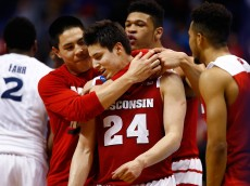 ST LOUIS, MO - MARCH 20:  Bronson Koenig #24 of the Wisconsin Badgers celebrates with teammates after making the game winning buzzer beater basket against the Xavier Musketeers during the second round of the 2016 NCAA Men's Basketball Tournament at Scottrade Center on March 20, 2016 in St Louis, Missouri.  (Photo by Jamie Squire/Getty Images)