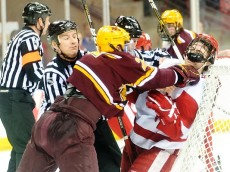 On Feb. 18, 2011, a Minnesota player punches a member of the UW-Madison team during a men's hockey game between the University of Wisconsin-Madison and Minnesota at the Kohl Center. Minnesota won the game 5-2. (Photo by Bryce Richter / UW-Madison)