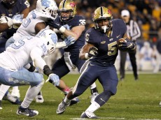 PITTSBURGH, PA - OCTOBER 29:  Chris James #5 of the Pittsburgh Panthers rushes against Donnie Miles #15 of the North Carolina Tar Heels in the second half during the game on October 29, 2015 at Heinz Field in Pittsburgh, Pennsylvania.  (Photo by Justin K. Aller/Getty Images)