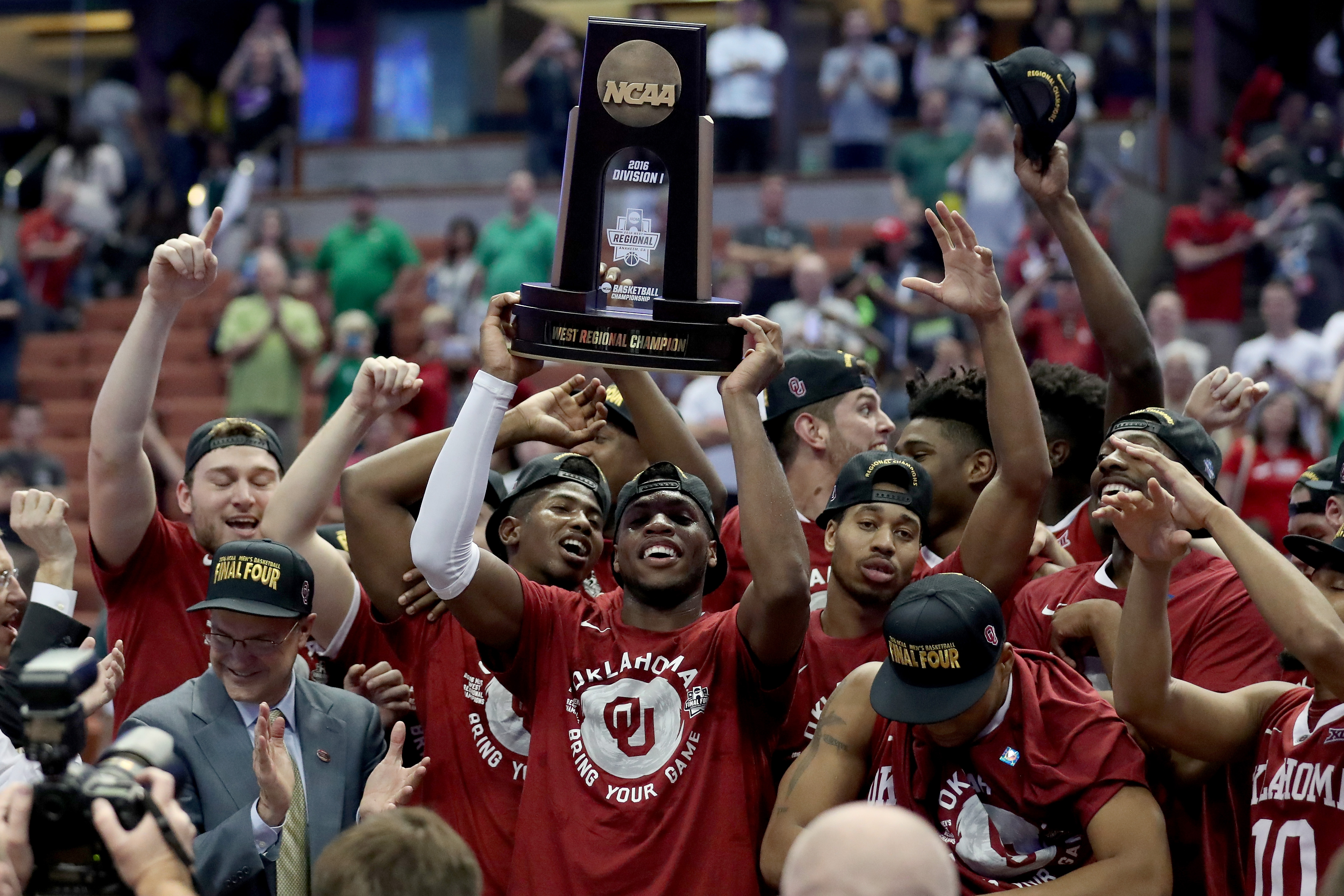 ANAHEIM, CA - MARCH 26:  Buddy Hield #24 of the Oklahoma Sooners holds up the West Regional trophy after the Sooners 80-68 victory against the Oregon Ducks in the NCAA Men's Basketball Tournament West Regional Final at Honda Center on March 26, 2016 in Anaheim, California.  (Photo by Sean M. Haffey/Getty Images)