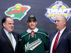 BUFFALO, NY - JUNE 24:  Luke Kunin celebrates with the Minnesota Wild after being selected 15th overall during round one of the 2016 NHL Draft on June 24, 2016 in Buffalo, New York.  (Photo by Bruce Bennett/Getty Images)