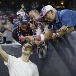 HOUSTON, TX - OCTOBER 08: Sam Dekker of the Houston Rockets takes a picture with fans before the Houston Texans played the Indianapolis Colts on October 8, 2015 at NRG Stadium in Houston, Texas. (Photo by Bob Levey/Getty Images)