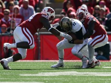 MADISON, WI - OCTOBER 17:  David Blough #11 of the Purdue Boilermakers is sacked by Chris Orr #50 and Chikwe Obasih #34 of the Wisconsin Badgers during the third quarter of a game at Camp Randall Stadium on October 17, 2015 in Madison, Wisconsin.  (Photo by Stacy Revere/Getty Images)