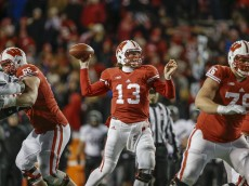 MADISON, WI - NOVEMBER 21: Quarterback Bart Houston #13 of the Wisconsin Badgers comes in on the last play of the game needing a touchdown against the Northwestern Wildcats on November 21, 2015 at Camp Randall Stadium in Madison, Wisconsin. The pass was incomplete in the end zone. (Photo by Tom Lynn/Getty Images)