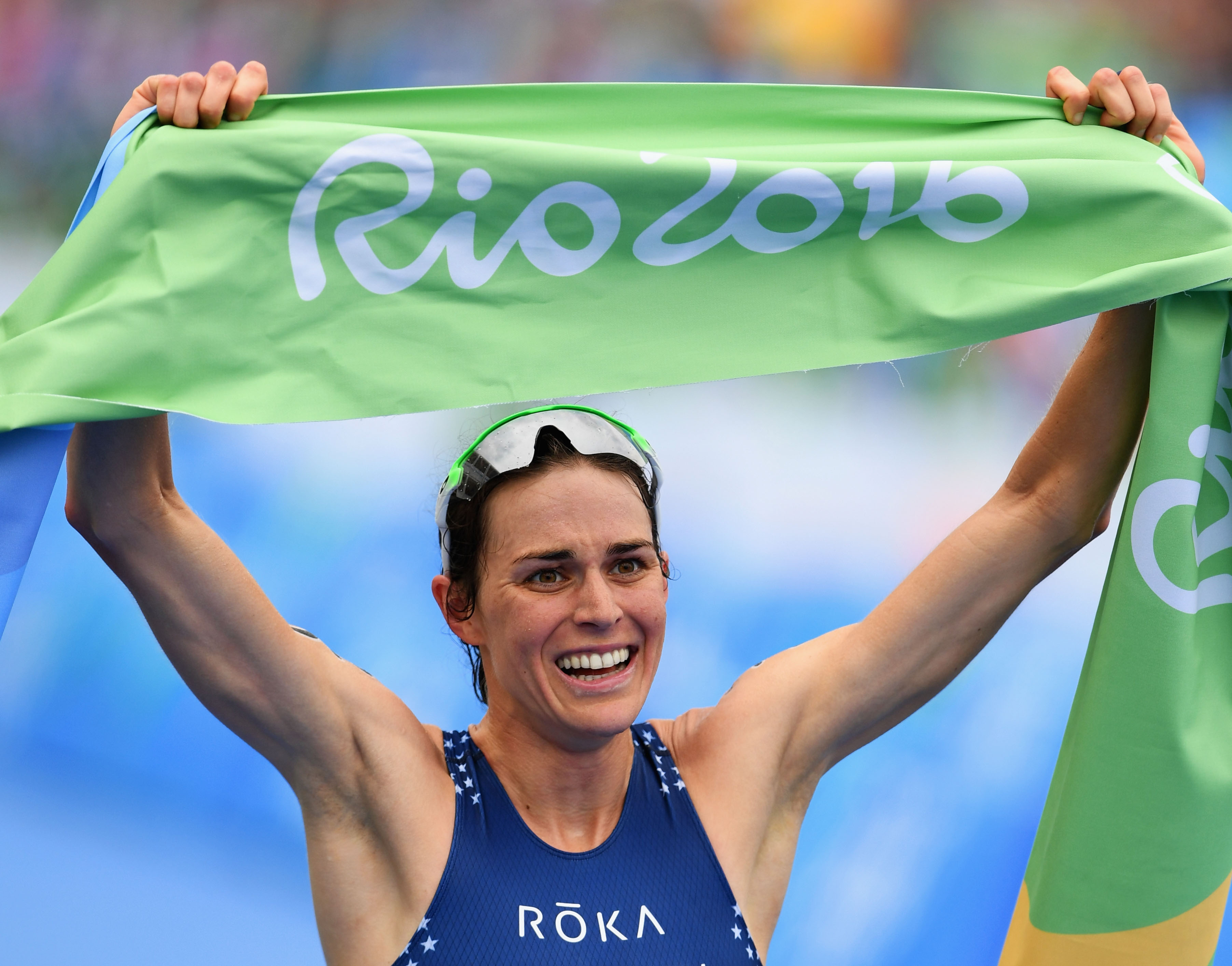 RIO DE JANEIRO, BRAZIL - AUGUST 20:  Gwen Jorgensen of the United States celebrates as she wins gold during the Women's Triathlon on Day 15 of the Rio 2016 Olympic Games at Fort Copacabana on August 20, 2016 in Rio de Janeiro, Brazil.  (Photo by Quinn Rooney/Getty Images)