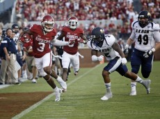 NORMAN, OK - SEPTEMBER 5:  Wide receiver Sterling Shepard #3 of the Oklahoma Sooners runs down the line as defensive back Larry Hope #2 of the Akron Zips defends September 5, 2015 at Gaylord Family-Oklahoma Memorial Stadium in Norman, Oklahoma.  (Photo by Brett Deering/Getty Images)