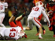COLLEGE PARK, MD - NOVEMBER 07: Joe Riddle #29 of the Maryland Terrapins is tackled by Ryan Connelly #43 of the Wisconsin Badgers during a kick-off return in the second half at Byrd Stadium on November 7, 2015 in College Park, Maryland. Wisconsin won, 31-24. (Photo by Patrick Smith/Getty Images)