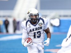 BOISE, ID - DECEMBER 22:  Quarterback Thomas Woodson #13 of the Akron Zips scrambles for a long gain during first half action in the Famous Idaho Potato Bowl against the Utah State Aggies on December 22, 2015 at Albertsons Stadium in Boise, Idaho. (Photo by Loren Orr/Getty Images)