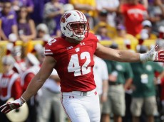 GREEN BAY, WI - SEPTEMBER 03:  T.J. Watt #42 of the Wisconsin Badgers reacts during the first half against the LSU Tigers at Lambeau Field on September 3, 2016 in Green Bay, Wisconsin.  (Photo by Jonathan Daniel/Getty Images)