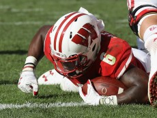 GREEN BAY, WI - SEPTEMBER 03:  Corey Clement #6 of the Wisconsin Badgers scores a touchdown during the third quarter against the LSU Tigers at Lambeau Field on September 3, 2016 in Green Bay, Wisconsin.  (Photo by Jonathan Daniel/Getty Images)