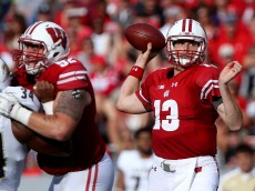 MADISON, WI - SEPTEMBER 10:  Bart Houston #13 of the Wisconsin Badgers throws a pass in the third quarter against the Akron Zips at Camp Randall Stadium on September 10, 2016 in Madison, Wisconsin. (Photo by Dylan Buell/Getty Images)