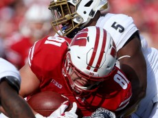 MADISON, WI - SEPTEMBER 10:  Ulysees Gilbert III #5 of the Akron Zips tackles Troy Fumagalli #81 of the Wisconsin Badgers in the third quarter at Camp Randall Stadium on September 10, 2016 in Madison, Wisconsin. (Photo by Dylan Buell/Getty Images)