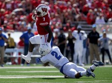 MADISON, WI - SEPTEMBER 17:  Bradrick Shaw #7 of the Wisconsin Badgers is tackled by Bobby Baker #2 of the Georgia State Panthers in the first quarter at Camp Randall Stadium on September 17, 2016 in Madison, Wisconsin. (Photo by Dylan Buell/Getty Images)
