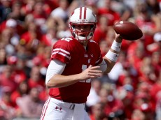 MADISON, WI - SEPTEMBER 17:  Alex Hornibrook #12 of the Wisconsin Badgers drops back to pass in the fourth quarter against the Georgia State Panthers at Camp Randall Stadium on September 17, 2016 in Madison, Wisconsin. (Photo by Dylan Buell/Getty Images)