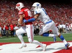 MADISON, WI - SEPTEMBER 17:  Kyle Penniston #49 of the Wisconsin Badgers scores a touchdown while being guarded by Bobby Baker #2 of the Georgia State Panthers in the fourth quarter at Camp Randall Stadium on September 17, 2016 in Madison, Wisconsin. (Photo by Dylan Buell/Getty Images)