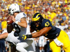 ANN ARBOR, MI - SEPTEMBER 24: Chris Wormley #43 of the Michigan Wolverines sacks quarterback Trace McSorley #9 of the Penn State Nittany Lions during the first quarter of the game at Michigan Stadium on September 24, 2016 in Ann Arbor, Michigan. (Photo by Leon Halip/Getty Images)