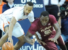 CHARLOTTESVILLE, VA - FEBRUARY 22:  Darion Atkins #5 of the Virginia Cavaliers and Michael Ojo #50 of the Florida State Seminoles fight for a loose ball during a college basketball game at John Paul Jones Arena on February 22, 2015 in Charlottesville, Virginia.  The Cavaliers won 51-41.  (Photo by Mitchell Layton/Getty Images)