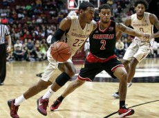 TALLAHASSEE, FL - FEBRUARY 28: Xavier Rathan-Mayes #22 of the Florida State Seminoles drives to the basket against Quentin Snider #2 of the Louisville Cardinals during the game at the Donald L. Tucker Center on February 28, 2015 in Tallahassee, Florida. (Photo by Don Juan Moore/Getty Images)