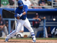 DUNEDIN, FL - MARCH 19:  Devon Travis #77 of the Toronto Blue Jays swings at a pitch during the third inning of a spring training game against the Boston Red Sox at Florida Auto Exchange Stadium on March 19, 2015 in Dunedin, Florida.  (Photo by Stacy Revere/Getty Images)