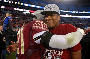 CHARLOTTE, NC - DECEMBER 06:  Jameis Winston #5 of the Florida State Seminoles celebrates after their 37-35 victory over the Georgia Tech Yellow Jackets at the ACC Championship game on December 6, 2014 in Charlotte, North Carolina.  (Photo by Mike Ehrmann/Getty Images)