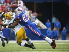 ORCHARD PARK, NY - DECEMBER 14:   Richard Rodgers #89 of the Green Bay Packers has a pass broken up by Nigel Bradham #53 of the Buffalo Bills during the first half at Ralph Wilson Stadium on December 14, 2014 in Orchard Park, New York.  (Photo by Tom Szczerbowski/Getty Images)