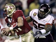 JACKSONVILLE, FL - DECEMBER 3:  Defensive end Darryl Tapp #55 of the Virginia Tech Hokies tries to get a hold of quarterback Drew Weatherford #11 of the Florida State Seminoles in the inaugural ACC Championship Game at Alltel Stadium on December 3, 2005 in Jacksonville, Florida.  (Photo by Doug Benc/Getty Images)