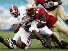 JACKSONVILLE, FL - SEPTEMBER 29: Running back 2  of the University of Alabama is tackled by Letroy Guion #93 of the Florida State University September 29, 2007 at Jacksonville Municipal Stadium in Jacksonville, Florida.  (Photo by Marc Serota/Getty Images)