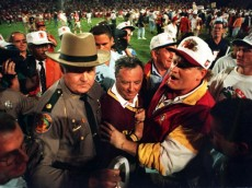 FLORIDA STATE SEMINOLES HEAD COACH COACH BOBBY BOWDEN IS ESCORTED OFF THE FIELD AFTER HIS TEAM DEFEATED NEBRASKA, 18-16 IN THE 1994 ORANGE BOWL IN MIAMI, FLORIDA.