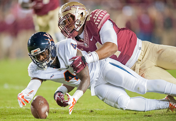 TALLAHASSEE, FL - NOVEMBER 8: Taquan Mizzell #4 of the Virginia Cavaliers and DeMarcus Walker #44 of the Florida State Seminoles go after a fumbled ball during the first half at Doak Campbell Stadium on November 8, 2014 in Tallahassee, Florida. (Photo by Jeff Gammons/Getty Images)
