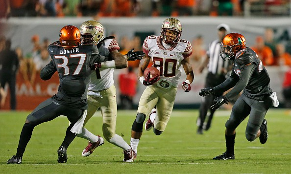 MIAMI GARDENS, FL - NOVEMBER 15: Rashad Greene #80 of the Florida State Seminoles runs with the ball against the Miami Hurricanes during fourth quarter action on November 15, 2014 at Sun Life Stadium in Miami Gardens, Florida. The Seminoles defeated the Hurricanes 30-26. (Photo by Joel Auerbach/Getty Images)