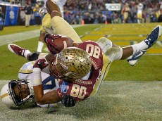 CHARLOTTE, NC - DECEMBER 06:  Rashad Greene #80 of the Florida State Seminoles makes a touchdown catch against Jamal Golden #4 of the Georgia Tech Yellow Jackets during the Atlantic Coast Conference championship game on December 6, 2014 in Greenville, North Carolina.  (Photo by Grant Halverson/Getty Images)