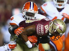 TALLAHASSEE, FL - SEPTEMBER 20:  Rashad Greene #80 of the Florida State Seminoles is tackled by Shaq Lawson #90 of the Clemson Tigers at Doak Campbell Stadium on September 20, 2014 in Tallahassee, Florida.  (Photo by Ronald Martinez/Getty Images)