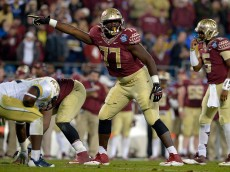 CHARLOTTE, NC - DECEMBER 06:  Roderick Johnson #77 of the Florida State Seminoles calls out his blocking assignment against the Georgia Tech Yellow Jackets in the 2nd half during the Atlantic Coast Conference championship game on December 6, 2014 in Greenville, North Carolina.  (Photo by Grant Halverson/Getty Images)