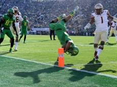 PASADENA, CA - JANUARY 01:  Wide receiver Charles Nelson #6 of the Oregon Ducks dives to the one-yard line in the first quarter of the College Football Playoff Semifinal against the Florida State Seminoles at the Rose Bowl Game presented by Northwestern Mutual at the Rose Bowl on January 1, 2015 in Pasadena, California.  (Photo by Harry How/Getty Images)