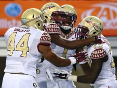 ARLINGTON, TX - AUGUST 30:  Jalen Ramsey #8, Cam Ponder #44 and Nate Andrews #29 of the Florida State Seminoles celebrates Andrews' interception against the Oklahoma State Cowboys in the first half of the Advocare Cowboys Classic at AT&T Stadium on August 30, 2014 in Arlington, Texas.  (Photo by Ronald Martinez/Getty Images)