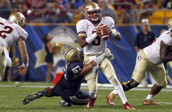 PITTSBURGH, PA - SEPTEMBER 02:  Jameis Winston #5 of the Florida State Seminoles scrambles in the second half against Aaron Donald #97 of the Pittsburgh Panthers during the game on September 2, 2013 at Heinz Field in Pittsburgh, Pennsylvania.  (Photo by Justin K. Aller/Getty Images)