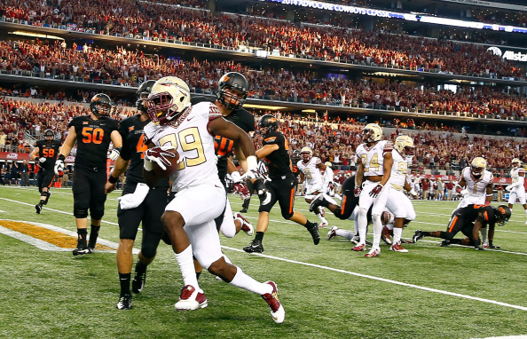 ARLINGTON, TX - AUGUST 30:  Nate Andrews #29 of the Florida State Seminoles scores on an interception return against the Oklahoma State Cowboys in the first half of the Advocare Cowboys Classic at AT&T Stadium on August 30, 2014 in Arlington, Texas.  (Photo by Tom Pennington/Getty Images)