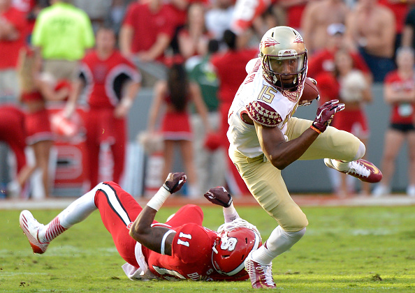 RALEIGH, NC - SEPTEMBER 27: Travis Rudolph #15 of the Florida State Seminoles breaks away from Juston Burris #11 of the North Carolina State Wolfpack during their game at Carter-Finley Stadium on September 27, 2014 in Raleigh, North Carolina. Florida State won 56-41. (Photo by Grant Halverson/Getty Images)