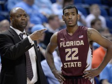 GREENSBORO, NC - MARCH 11:  Head coach Leonard Hamiton talks with Xavier Rathan-Mayes #22 of the Florida State Seminoles against the Clemson Tigers during a second round game of the ACC basketball tournament at Greensboro Coliseum on March 11, 2015 in Greensboro, North Carolina.  (Photo by Grant Halverson/Getty Images)