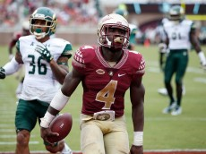 TALLAHASSEE, FL - SEPTEMBER 12: Dalvin Cook #4 of the Florida State Seminoles runs for a 24-yard touchdown against the South Florida Bulls in the third quarter at Doak Campbell Stadium on September 12, 2015 in Tallahassee, Florida. Florida State defeated South Florida 34-14. (Photo by Joe Robbins/Getty Images)
