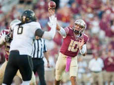 TALLAHASSEE, FL - OCTOBER 4: Sean Maguire #10 of the Florida State Seminoles makes a pass against the Wake Forest Demon Deacons during the second half at Doak Campbell Stadium on October 4, 2014 in Tallahassee, Florida. The Seminoles took the Deamon Deacons 43-3. (Photo by Jeff Gammons/Getty Images)