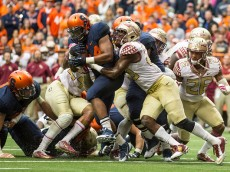 SYRACUSE, NY - OCTOBER 11:  Adonis Ameen-Moore #34 of the Syracuse Orange is held up short of the goal line by Florida State Seminoles during the second quarter on October 11, 2014 at The Carrier Dome in Syracuse, New York.  (Photo by Brett Carlsen/Getty Images)