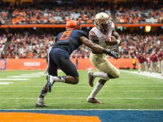 SYRACUSE, NY - OCTOBER 11:  Dalvin Cook #4 of the Florida State Seminoles stretches to score a touchdown on a 7 yard run during the fourth quarter on October 11, 2014 at The Carrier Dome in Syracuse, New York.  Florida State Seminoles defeat Syracuse Orange 38-20.  (Photo by Brett Carlsen/Getty Images)