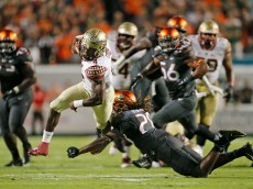 MIAMI GARDENS, FL - NOVEMBER 15: Dalvin Cook #4 of the Florida State Seminoles runs past Nantambu-Akil Fentress #28 of the Miami Hurricanes to score the winning touchdown during fourth quarter action on November 15, 2014 at Sun Life Stadium in Miami Gardens, Florida. The Seminoles defeated the Hurricanes 30-26. (Photo by Joel Auerbach/Getty Images)