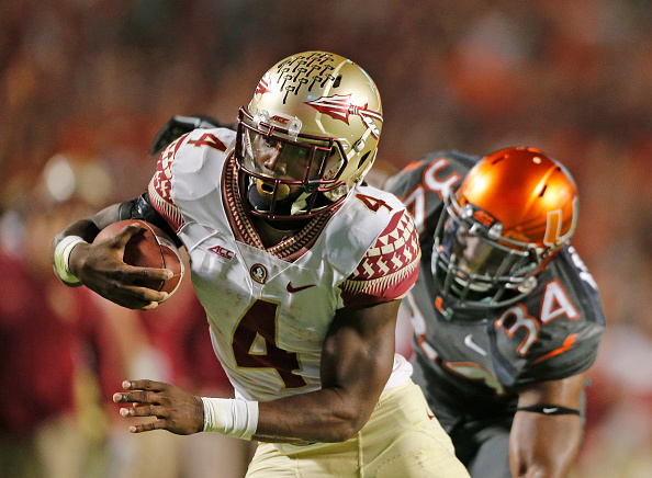MIAMI GARDENS, FL - NOVEMBER 15: Dalvin Cook #4 of the Florida State Seminoles scores the winning touchdown in the fourth quarter against the Miami Hurricanes on November 15, 2014 at Sun Life Stadium in Miami Gardens, Florida. The Seminoles defeated the Hurricanes 30-26. (Photo by Joel Auerbach/Getty Images)